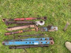Various tractor lift arms and bars
