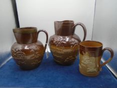 2 Royal Doulton Lambeth Harvest jugs, 23cm and 20cm tall (small chip to rim on largest) plus Lambeth