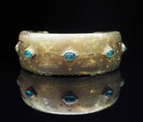 Emerald and 18ct yellow gold cuff bangle