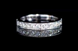 Twelve stone diamond and 18ct white gold ring