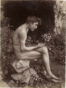 Gloeden, Wilhelm von: Young male nude contemplating flower