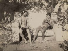 Gloeden, Wilhelm von: Two male nudes on bench