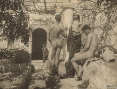 Gloeden, Wilhelm von: Young male nudes on terrace with trellis