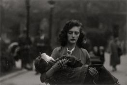 Arbus, Diane: Woman carrying a child in Central Park, N.Y.C.