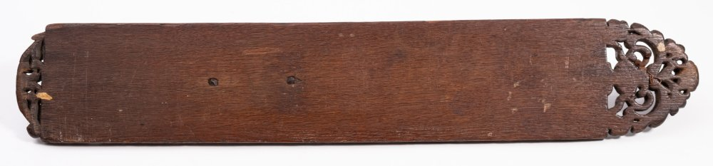 Lot 474 - An 18th Century oak mangle board: of arched rectangular form,