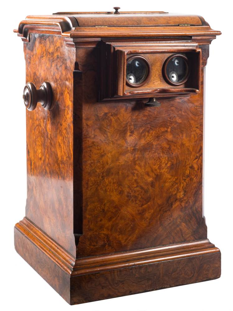 A Victorian Walnut tabletop stereoscope viewer: unsigned, the arched moulded top with mirror,