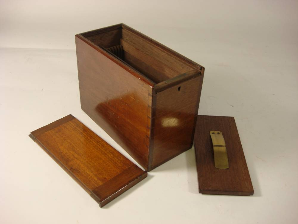 A late 19th century mahogany stereoscope slide box: with brass sprung retaining cover under sliding