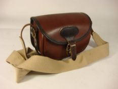 A Parker-Hale leather cartridge bag:, 'CB 75-S' pattern.