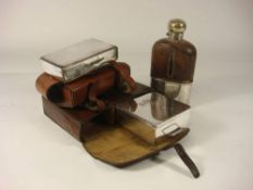 Two silver plated sandwich boxes in leather cases and a glass and silver plated drinking flask: (3)