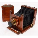 A Thornton Pickard mahogany and brass camera: fitted f8-64 brass lens,