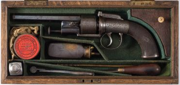 A rare cased percussion cap hammer sighted transitional six shot revolver by Joseph Bourne: the 5