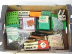 A quantity of various reloading equipment including bullet moulds etc.