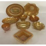 A box of vintage Carnival style lustre glass in orange colourway.