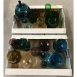 A large collection of vintage coloured glass items.