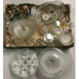 A collection of vintage and modern glassware.