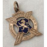 "A 9ct gold ""Dunedin Lodge S.O.O"" medallion with enamelled shield & rampant lion decoration."