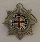 A vintage Coldstream Guards Warrant Officers cap badge.