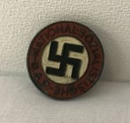 A German WWII style Ersatz late war N.S.D.A.P button hole party badge.