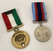 A 1991 Kuwait liberation medal together with a Pakistan Air Force medal. Both with ribbons.