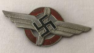 A WWII style German D.L.V (Deutscher Luftsportverband) cap badge.
