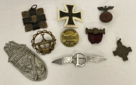 A small collection of military related badges to include German and a handmade sweetheart brooch.
