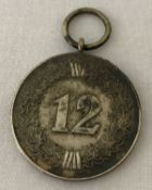 A WWII style German Army 12 year long service medal, no ribbon.