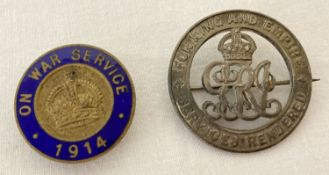 2 WWI service badges, one with blue enamel detail.
