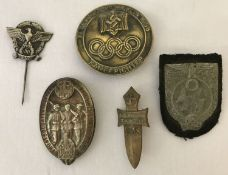 """5 assorted WWII style German """"Tinny"""" badges."""