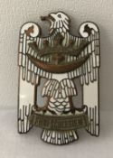 A German Post WWI style Friekorps badge with white enamelled detail.