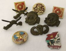 10 Vietnam War era badges to include screw back, pin back and lug fixings.