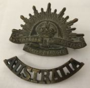 A WWI style Australian Rising Sun cap badge and shoulder title.