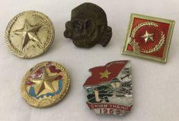 A small collection of Vietnam era Viet Cong badges.