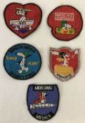 5 Vietnam War era embroidered Snoopy patches.
