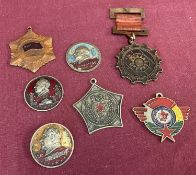 A collection of 7 vintage Chinese military medals and badges.