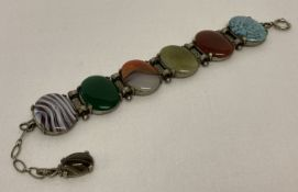 A vintage Scottish Miracle bracelet set with 6 large oval shaped glass cabochons.