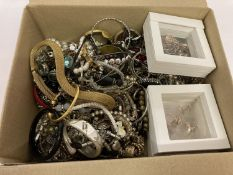 A box of mixed vintage and modern costume jewellery to include bracelets, bangles and necklaces.