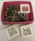 A basket of mostly silver and gold tone costume jewellery to include necklaces and gift sets.