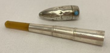 An early 20th century hallmarked silver folding cigarette holder in chatelaine case.
