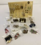 32 pairs of stud and drop style costume jewellery earrings to include vintage and modern designs.