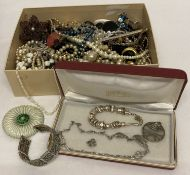 A box of vintage and modern costume jewellery necklaces, brooches and bracelets.