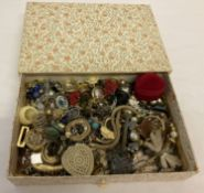 A box of vintage and modern costume jewellery, mostly rings and earrings.