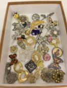 A collection of vintage and modern, brooches, scarf clips and hat pins.