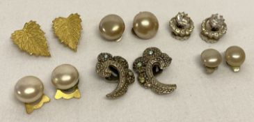 A collection of vintage clip-on earrings to include stone set, some with silver backs.