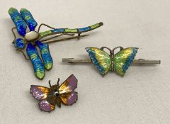 A vintage silver bar brooch set with green, yellow and blue enamelled butterfly.