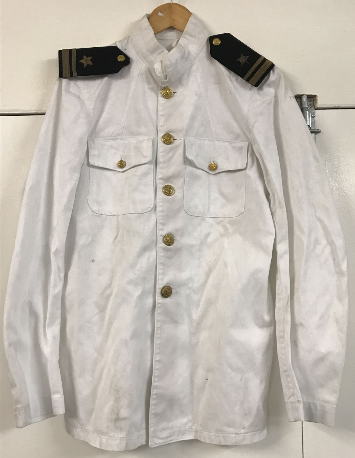 Lot 141 - A vintage US Navy style white tunic with buttons and shoulder boards.