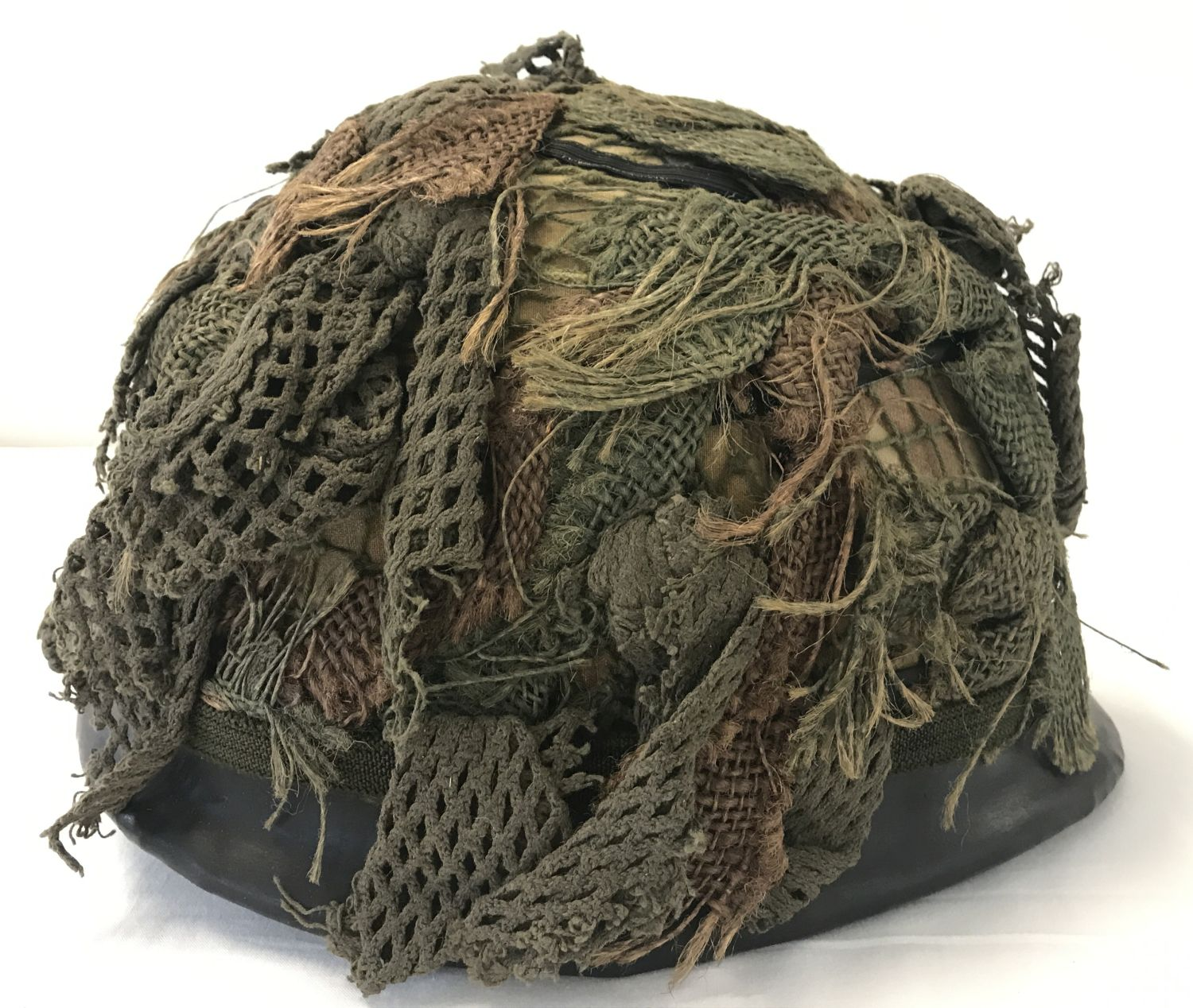 Lot 125 - A Belgian Army OTAN M1951 steel helmet, US M1 style, circa 1985. With net and scrim.