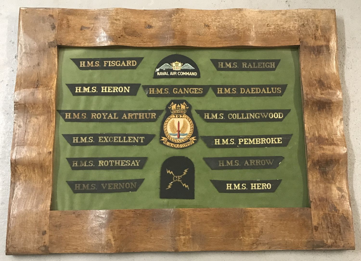 Lot 78 - A framed and glazed mounted collection of Naval cap Tally's and cloth badges.