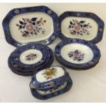 A quantity of early 19th Century Copeland Spode dinner ware of floral design with Royal Blue border