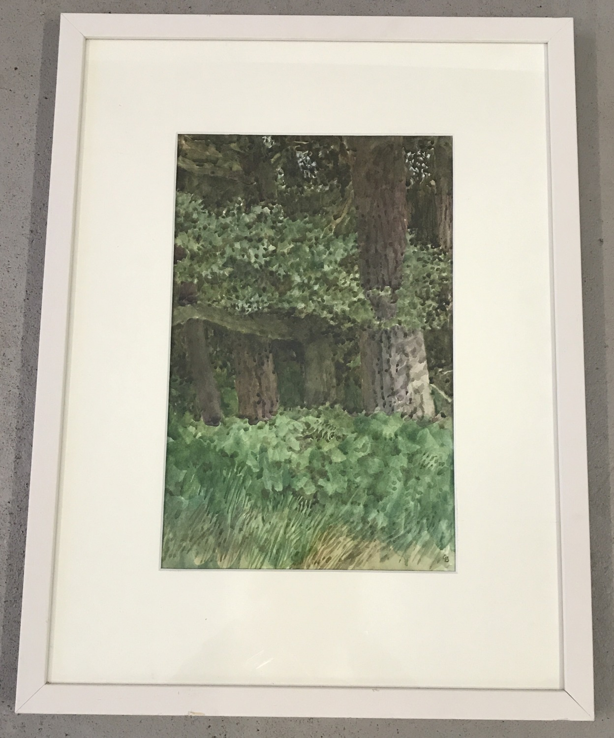 Lot 441 - A vintage framed & glazed watercolour of woodland by Colin Bygrave. In a white wooden frame.