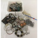 A tub of mixed costume jewellery necklaces, bangles and earrings, some still on original cards.